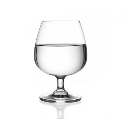 intoxicant: Water in glass on white background Stock Photo