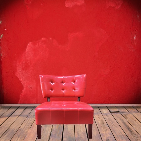 abandon: Old leather amrchai in red interior room with wooden floor