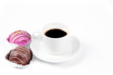 Black coffee cup with sweet chocolate photo