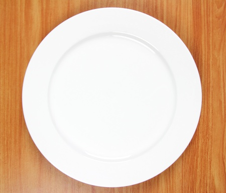 Empty plate on wood background Stock Photo - 13288642