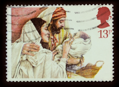 antique jesus: UNITED KINGDOM - CIRCA 1984  A stamp printed in the United Kingdom shows a Christmas postage stamp with Mary, Joseph and Baby Jesus, circa 1984