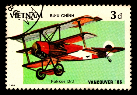 VIETNAM - CIRCA 1986  A stamp printed by VIETNAM shows military aircraft   Fokker Dr I   Circa 1986 photo