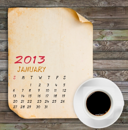 January 2013 Calendar, Vintage paper with Black coffee on wood panels background Stock Photo