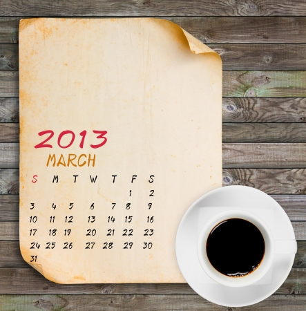 March 2013 Calendar, Vintage paper with Black coffee on wood panels background Stock Photo