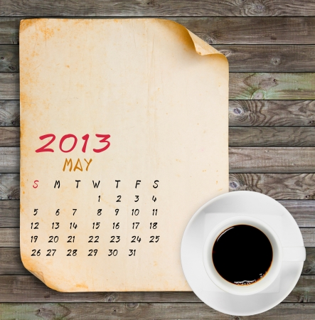 May 2013 Calendar, Vintage paper with Black coffee on wood panels background photo