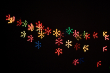 Abstract snow flakes light in black background Stock Photo - 17115278