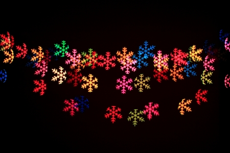 Abstract snow flakes light in black background Stock Photo - 17115279