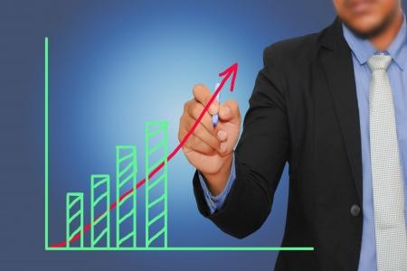 Businessman writing graph Stock Photo - 17115287
