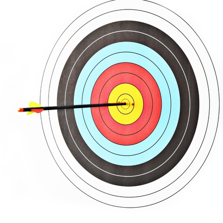 Archery target with arrow on white background photo