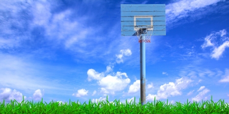Basketball hoop over a beautiful blue sky background photo