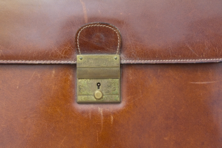 business case: Close-up of lock on leather business case ,for background