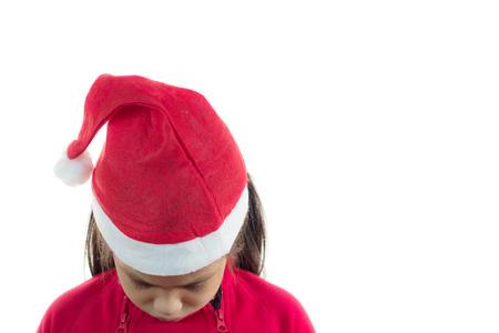 alone sad: Little girl in the santa claus hat, feeling so sad Stock Photo