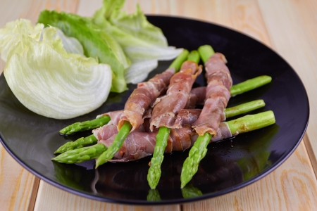 Grilled asparagus warapped in Parma ham  photo