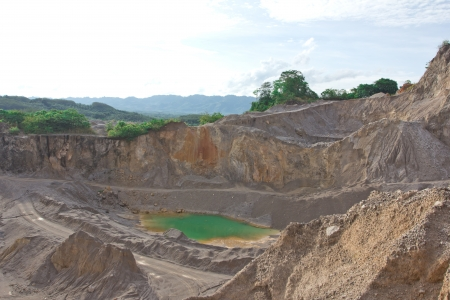 Blue lake in mining industrial crater photo