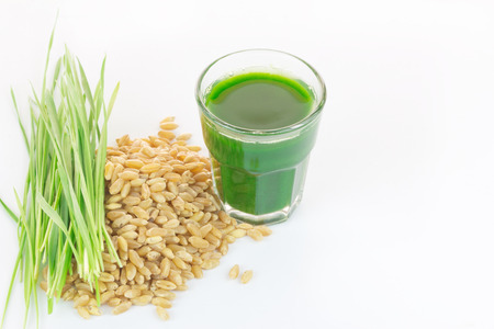 wheat grass: Wheat grass juice with fresh wheat grass and wheat on white background