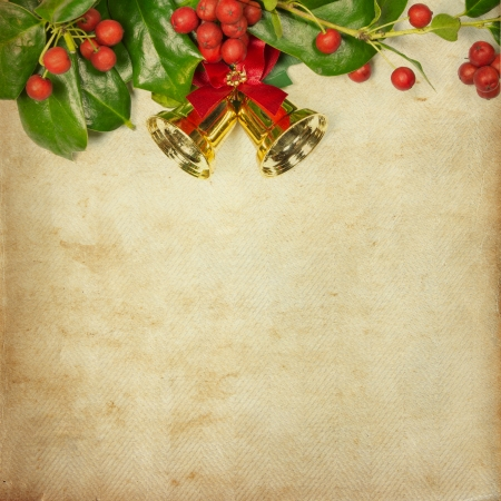 Holly Christmas decoration retro Card, on vintage paper background photo