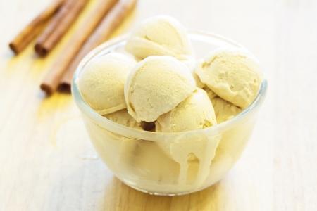 Home made, Scoop of homemade cinnamon ice cream with cinnamon photo