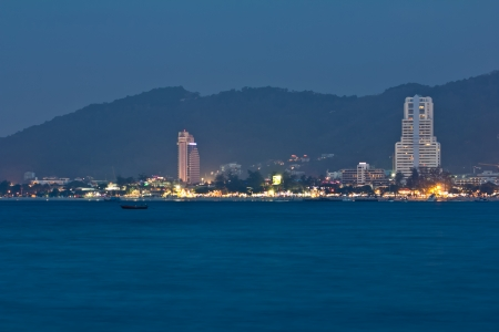 Patong City at night view from Sea photo