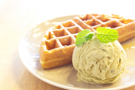 Waffle with green tea ice cream on wood photo