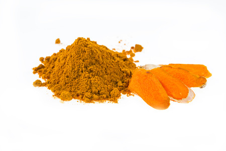 turmeric powder with fresh turmeric root on white background photo