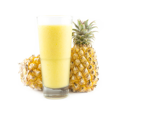 pineapple smoothie with fresh pineapple on white background photo