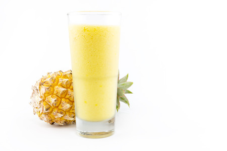 pineapple  glass: pineapple smoothie with fresh pineapple on white background Stock Photo
