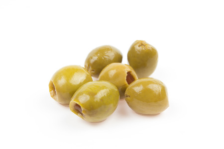 pitted: Pitted green olives isolated on white  Stock Photo