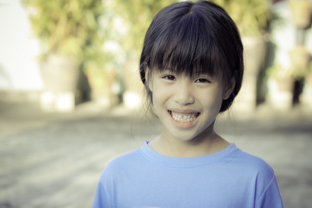 eight year old: portrait of happy 6 year old asian girl