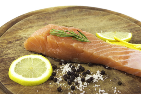 rosmarin: Close up Fresh salmon with spices on wood  Stock Photo