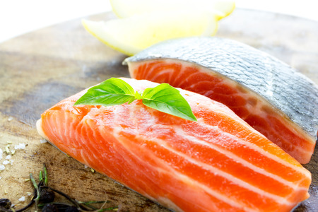 rosmarin: Close up Fresh salmon with spices on old wood  Stock Photo