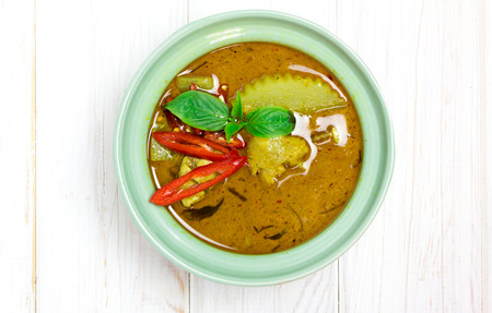 chicken rice: Spicy Chicken green curry, thai cuisine top view on wood  Stock Photo