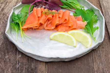 blubber: Smoke salmon with salad on old wood Stock Photo