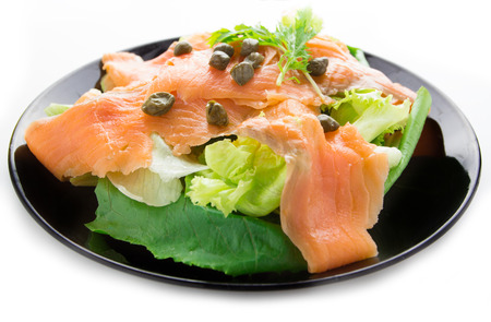 blubber: Smoke salmon with salad on plate over white background Stock Photo