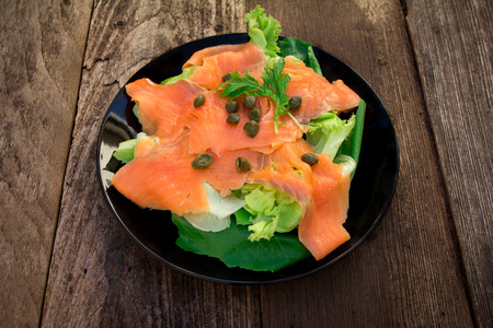 blubber: smoked salmon salad on old wood table   Stock Photo