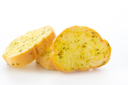 Close up Garlic and herb bread slices on white background