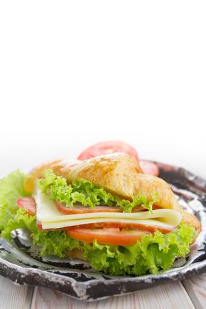 Close up Sandwich crosisant on wood background photo