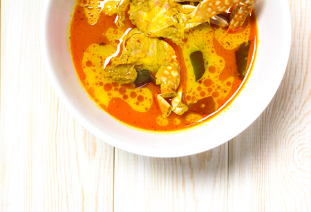coconut crab: Spicy coconut milk soup with crab on wood, top view Stock Photo