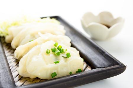 gyoza: Gyoza or potstickers on a plate  Stock Photo
