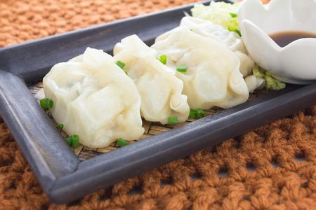 gyoza: Gyoza or potstickers on a plate, close up