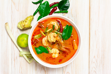 Tom Yam Kung, Spicy Thai food on wood background Stock Photo
