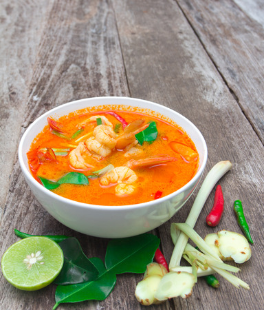 favorite soup: Tom Yam Kung, Spicy Thai food on old wood  Stock Photo