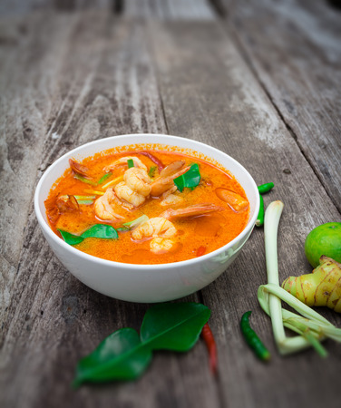 favorite soup: Tom Yam Kung, Spicy Thai food on old wood background