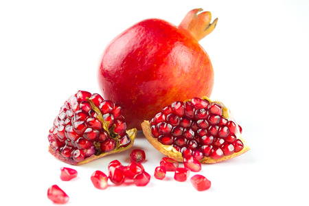 Juicy pomegranates on white background photo