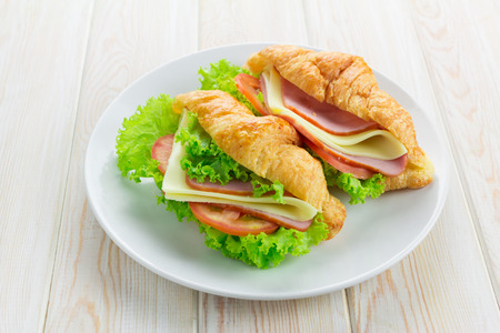 sandwish: Sandwish croissant on wood table Stock Photo