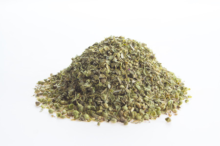 Dried oregano leaves on a white background  photo