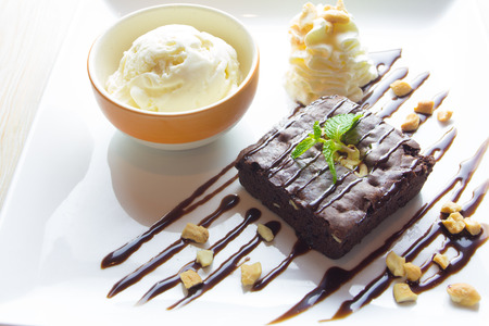 drizzle: Brownie with ice cream on the dish Stock Photo
