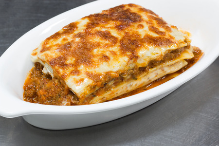 italian lasagna on white plate photo