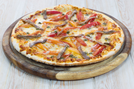 Delicious pizza on wood table photo