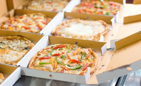 Pizza in box at the kitchen Archivio Fotografico