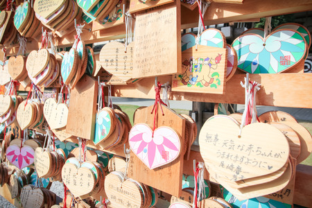 ema: KYOTO, JAPAN - October 10: Heart shape of wishing wood tag (Ema) hanging in Yasaka shrine on October 10, 2014 in Kyoto, JAPAN. .